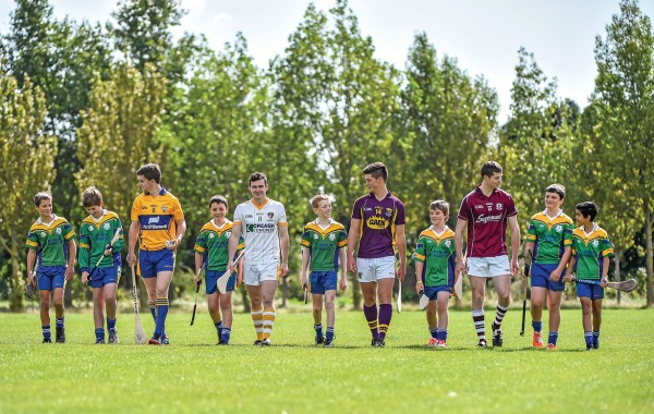 Some of our U-12 hurlers proudly stepping out with the captains of the country's U-21 elite hurling teams. Left to right: Tony Kelly (Clare), Stephen McAfee (Antrim), Conor McDonald (Wexford) and Cathal Mannion (Galway).