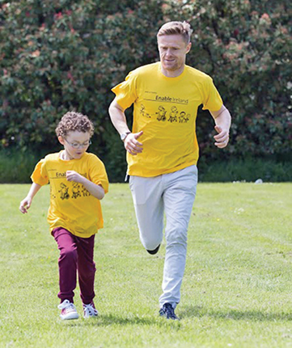 Damien Duff and friend wear the Enable Ireland shirt.