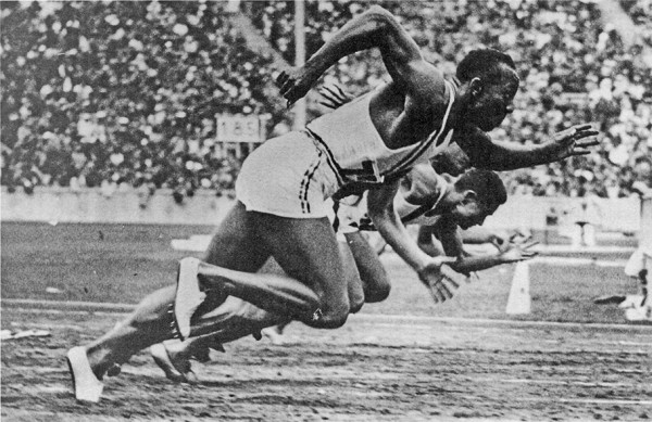 Jesse Owens winning gold in the 1936 Berlin Olympics.