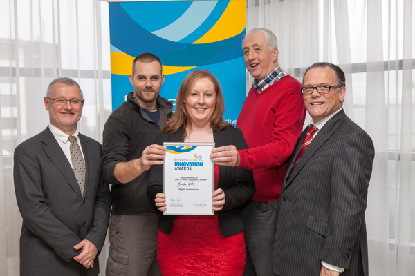 Seán Egan, Chairman of the Rehab Group Board (left), and Don Tallon, Chairman of the Adjudicating Committee for the Rehab Group Innovation Awards 2014 (far right), presented Dave Hedges, Co-owner Wild Geese Martial Arts (centre left), Nessa Canavan, Community Services Manager, RehabCare HOPS and Mick Sharkey with their highly commended Innovation Award for the fundraiser, One Mile Kettlebell Walk. Pic: Iain White