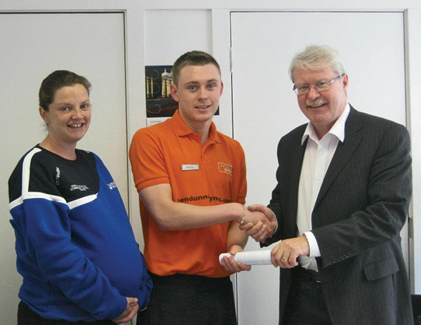 Pictured, from left: Avril Winters (Sports Instructor), Anthony O'Callaghan (Learner) and  Denis Murphy (Manager).