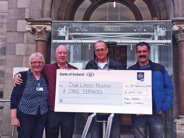 With the cheque for €2893.20 from the Paul Behan Darts Classic, left to right: Cepta (finance manager Our Lady's Hospice, Blackrock), Christy Murphy, Joe Corri and Joe Sadler.