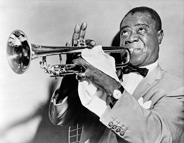"""Above: Jazz, here being played by Louis Armstrong, was considered the music of """"savages"""" by many local councils."""