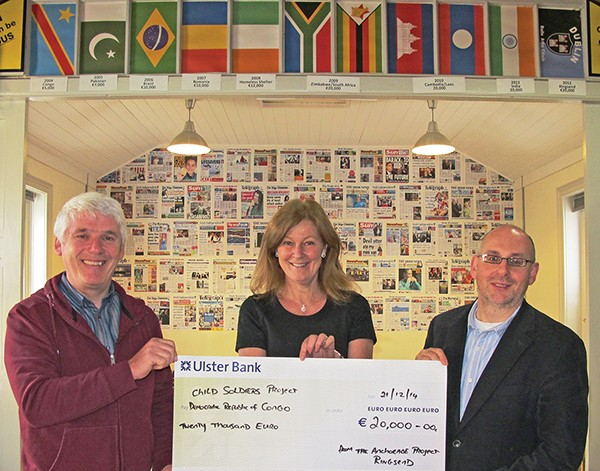 Pictured, from left: Joe and Sharon Donnelly with the cheque presented to Peter Byrne, director of Christian Aid Ireland. Image supplied by Joe Donnelly.