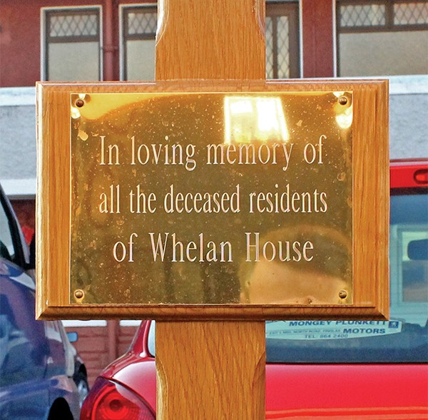 Pictured: This plaque was erected in loving memory of all the deceased residents of Whelan House and their families.