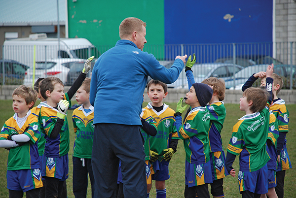 Above: The Clanna Gael Fontenoy U8s receive some orderly advice before the game from one of the coaches, Declan Darcy. Images supplied by Clanna Gael Fontenoy.
