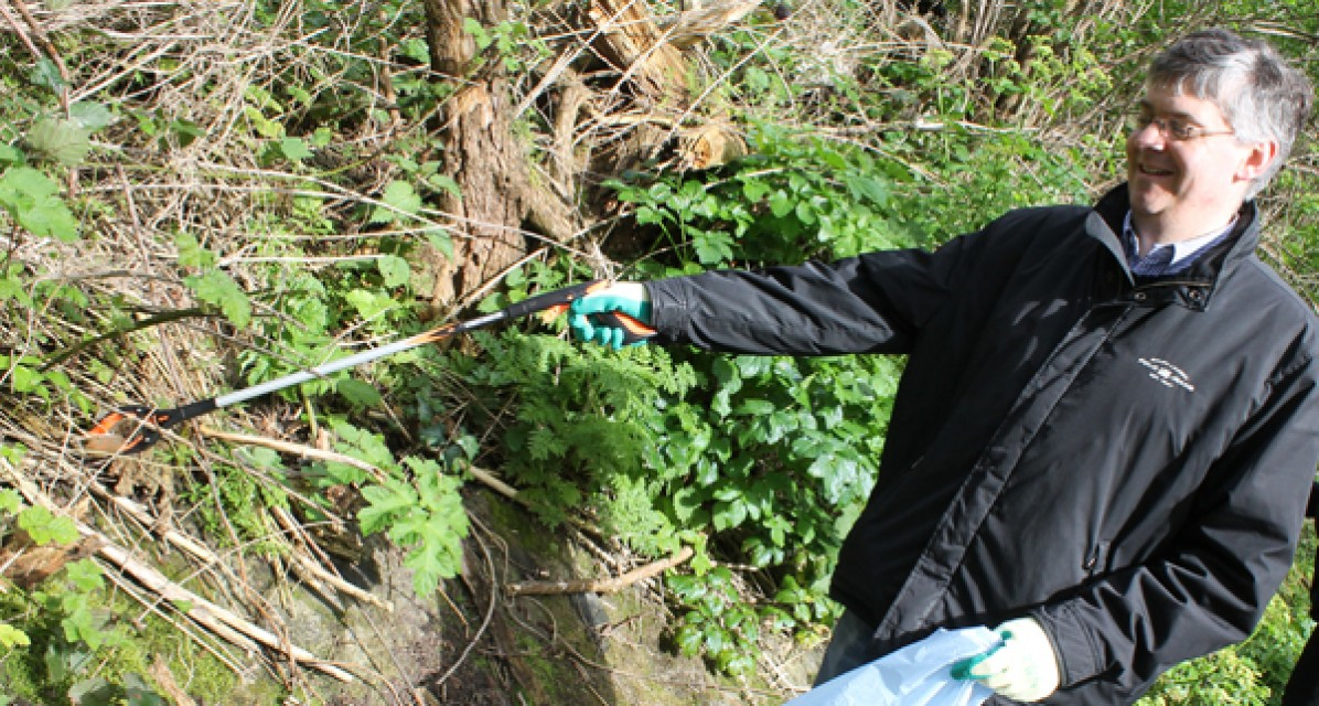 A volunteer helps out on Dodder Day 2014.