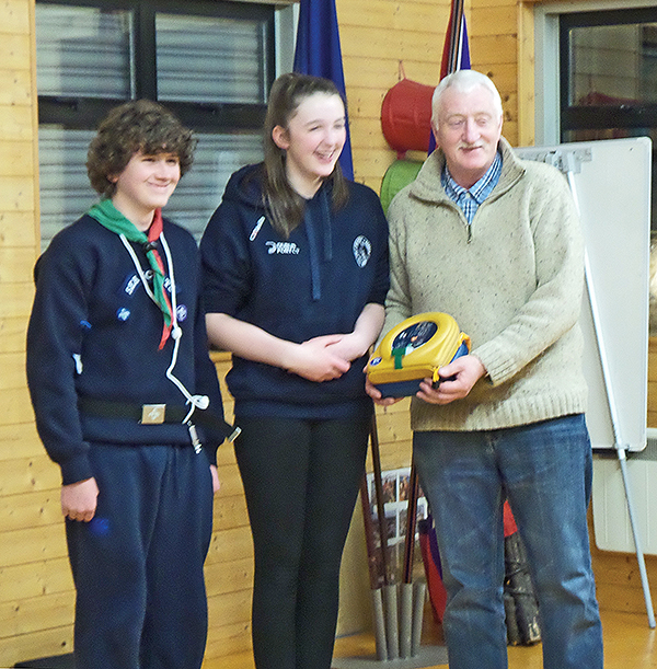 Pictured above: Sea Scouts Padraig and Hannah present a defibrillator to Joe McCann, Chair of BADRA. Image supplied by Dodder Sea Scouts.