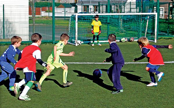 Above: Local kids enjoy football at Irishtown Stadium.