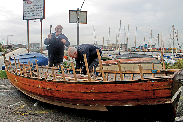 Derek Stewart and Mick Curry were recognised for providing their skills and expertise to the restoration of the training skiff at Stella Maris Rowing Club, ensuring the continuation of Ringsend's sea-faring traditions.