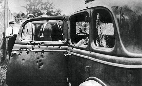 Pictured Above: The bullet-riddled Ford V8 in which they died.