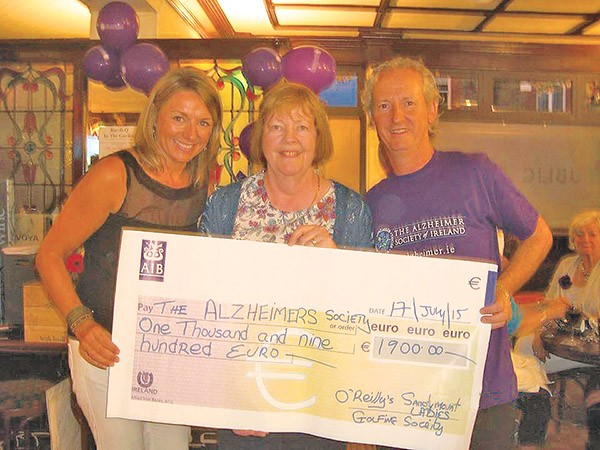 Pictured: Una Molony (left) presents Marian Winters (middle) and Dave Mahony (right) of Alzheimer Society of Ireland with a cheque for €1,900.