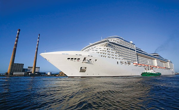 Pictured: MSC Splendida cruise liner being towed stern first into Dublin Port.