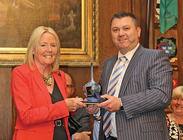 Pictured Above: Pat Ward from Dublin Port Company presents the Spellman Centre volunteer of the year award to Delores McCabe.