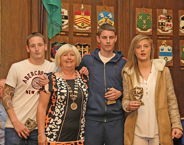 Pictured Above: Alice Foley presents the players' awards of the Spellman Tournament to Dillan O'Toole (RDRD) pictured on the left, Georgie Gannon representing winners Betsi 7 and Natalie as the women's soccer player choice.