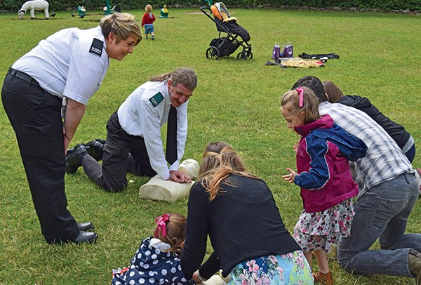 Pictured Above: Pat Behan demonstrates CPR.