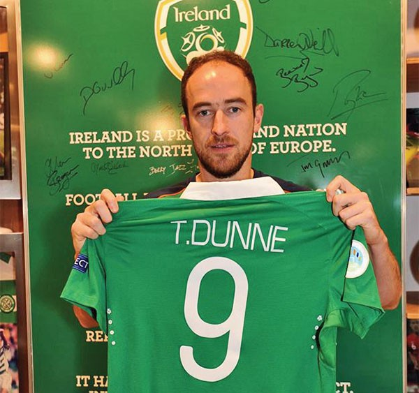 Pictured Above: Thomas Dunne with his region's final jersey.