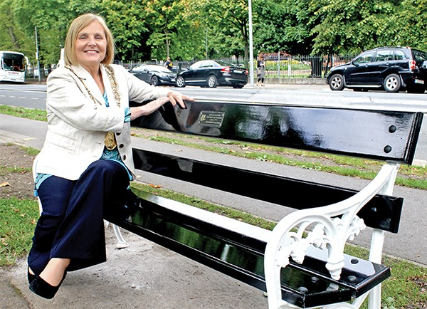 Pictured Above: Críona Ni Dhálaigh unveils the new bench on the Grand Canal.