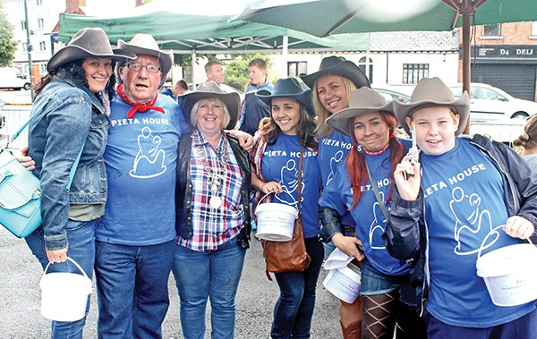 Pg 25 Volunteers collecting for Pieta House at Irishtown House's Wild West day, Saturday August 29th