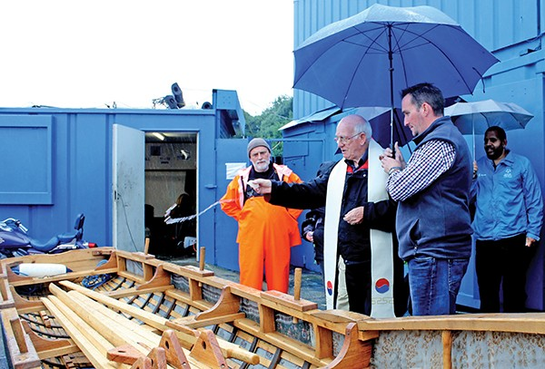 Pictured: Fr Derek Harris blessing the Currach at the Poolbeg Marina.