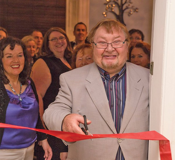 Pictured: Celebrity astrologer Fergus Gibson cuts the ribbon to open the store (Balrath Photography).