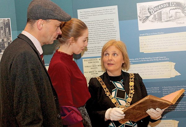 Pictured Above: James Barry, Seána Kerslake, and the Lord Mayor of Dublin Críona Ní Dhálaigh take a look at the fire brigade logbook from the Rising.