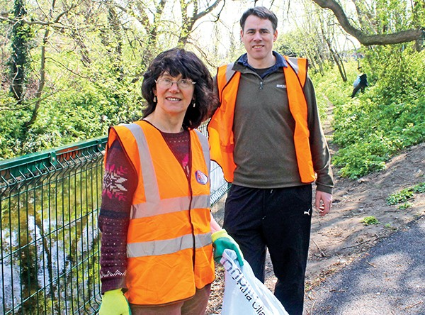 Above: Victoria White and John Lacey help clean-up Herbert Park.