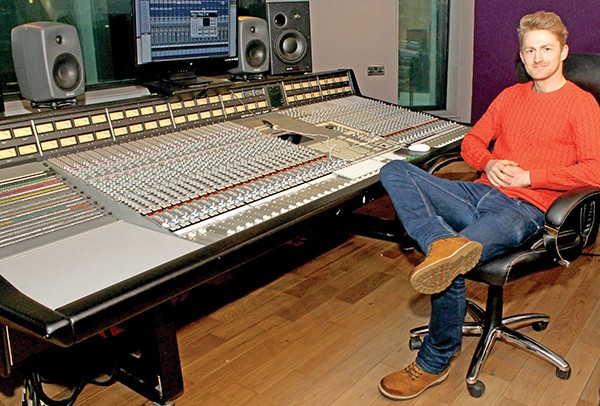 Pictured: Marketing Manager Ray sitting in the recording studio where U2 recorded their Pop Album.
