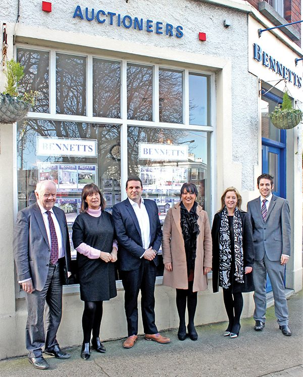 Above: Nigel Bennett (left) with all the staff at Bennetts Auctioneers.