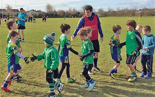 Pictured Above: U8 footballers v Lucan. Our U8 footballers shake hands with their counterparts from the Lucan Sarsfield club after their match.