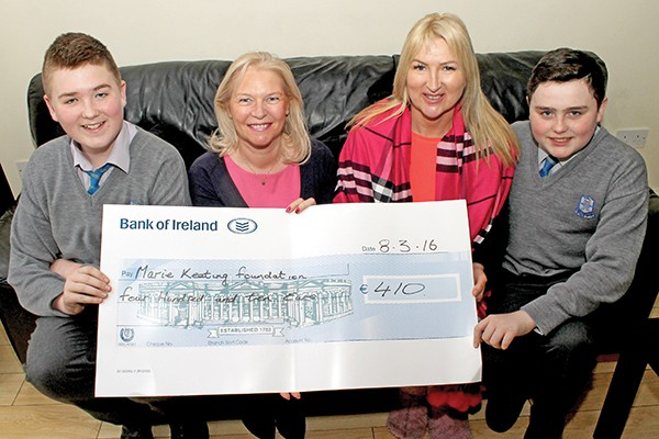 Pictured above: Brandon Caulfield, Linda Keating, Paula Caulfield, and Jamie Purcell with the cheque for €410 for the Marie Keating Foundation