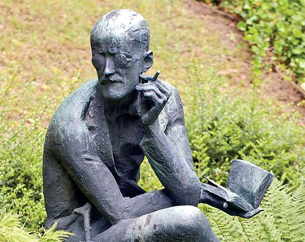 A sculpture of Irish author James Joyce is seen beside his grave at Fluntern cemetery in Zurich, Switzerland. (AP Photo/Keystone, Steffen Schmidt)