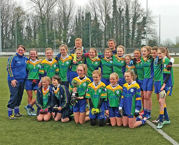 Féile Champions squad: L Crowe, Z Lynch, M Dunne, E Whelan, E Darcy, L Darcy, A Walsh, R Staunton (capt), L O'Shea, H Lewis, A Griffin, M Montgomery, J Dolly, E O'Neill, K Dunne, O Mohan, T Novak, E Bruton, S Vanshika. Also in picture are coaches Grace Dunne, Declan Darcy and James Dolly.