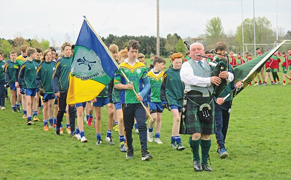 Above: Féile Parade: The Clanns team was led out by Joshua Hogan and Cian Morgan, both of whom missed out due to injuries previously picked up in the Hurling Féile.
