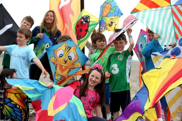 Repro Free: Dublin, 7th June 2016. Catherine Etienne from Pure Magic and a group of children from Dublin practise their kite flying at the launch of Dublin City Council's Dublin Kite Festival 2016 which takes place on Sunday, 12th June, in North Bull Island, Clontarf. This year's Dublin Kite Festival will attract attendees from around the country, brandishing an array of kites ready to take to the skies and beautify the Dublin skyline with a jumble of colour. The festival promises to be an unmissable day out with free entertainment all day long including; lively music, exciting games, kite making workshops, a kite flying competition and lots more! For more information visit www.dublincity.ie/kitefest. Picture Jason Clarke