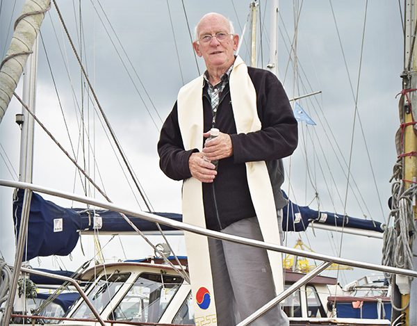 Above: Father Derek Harris, at home on the boats. Photo by Kevin O'Gorman.
