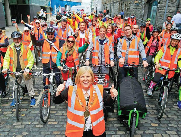 Pictured is Lord Mayor Críona Ní Dhálaigh with many of the participants of Safe Cycle. Image courtesy of Dublin Bike Week.