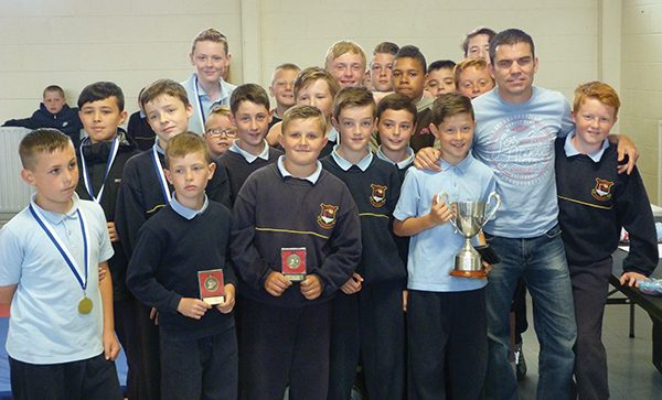 Pictured above: Bernard Dunne and the Soccer team.