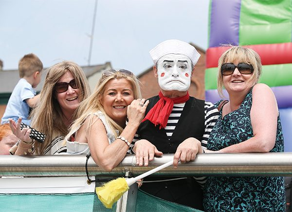 Pictured: Sisters Rita, Clare and Linda Farrell with entertainer Johnny Murphy.