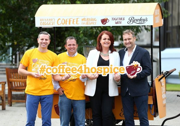 "On yer coffee trike! Mario Rosenstock and Davy Fitzgerald saddle up for Ireland's Biggest Coffee Morning for Hospice 2016 -Mario Rosenstock and legendary Clare manager, Davy Fitzgerald are calling on people across the country to get on board for Ireland's Biggest Coffee Morning for Hospice together with Bewley's on Thursday 15th September. Putting their barista skills to the test, the duo urged people to host a coffee morning or to share a cup of Bewleys' coffee to support their local hospice and their vital work caring for people in their local communities nationwide. To get involved visit www.hospicecoffeemorning.ie or call 1890 717 000. Mario Rosenstock said, ""I've been delighted to be involved with the hospice for a few years now and in that time I've seen at first-hand the work they do and the care they give. To continue giving this care, hospice services across the country need vital funds and Ireland's Biggest Coffee Morning for Hospice is the one day when everyone can get involved and help them to do just that. Whether you host a coffee morning of your own or visit a local coffee morning to enjoy a Bewley's coffee, your support is key as every cup counts"". Pictured at the launch at Our Lady's Hospice, Harold's Cross were (l-r) Bewley's Brand Director, Mark Saunders, Davy Fitzgerald, Katrina Buchanan of St. Francis Hospice and Mario Rosenstock."
