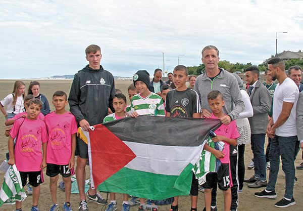 Above: Sean Boyd (Shamrock Rovers) and Chris Andrews with under 14 Gaza kids team players.