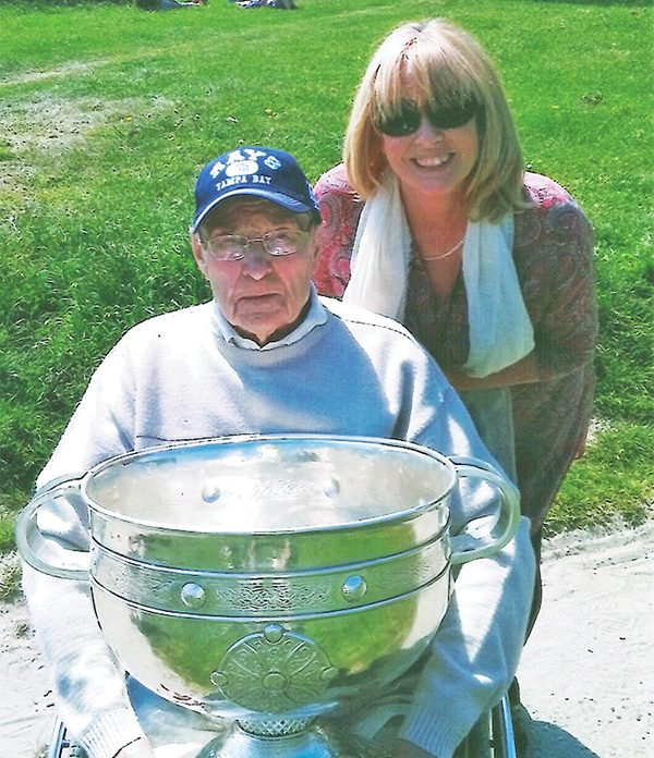 Pictured: Micko O'Neill at his 95th birthday celebration with his daughter Mary and the Sam Maguire Cup won by Dublin in 2015.