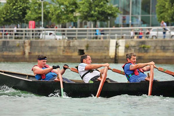 Pictured: Curragh racers on the Liffey. High winds do not deter the men from the West. Photo: John Hawkins.