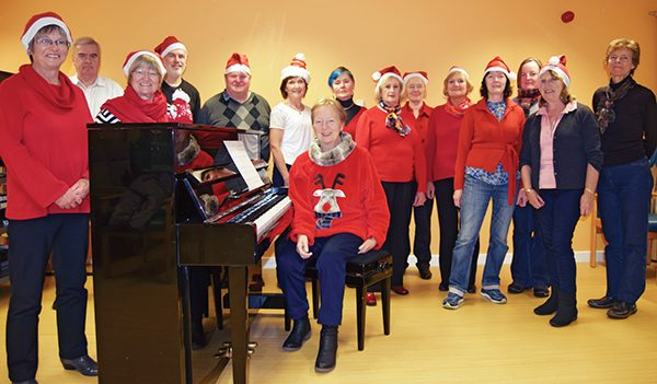 Pictured: Members of Ceiliúradh Choir get their practice in for the Christmas season.