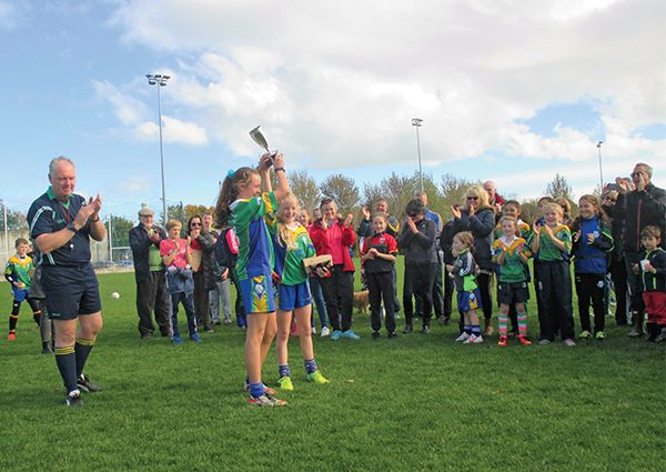 Pictured: Ali Griffen and Ella Darcy accept the cup and medals on behalf of the Division 2 Champions, Clanns U13 girls team – Olivia Mohan, Lauren O Brien, Jessica Dolly, Holly Lewis, Sophie Carr, Lauren Thirroueiz, Ella Bruton, Emear O Neill, Maura Montgomery, Lucy Crowe, Chelsea Brophy, Katie Dunne, Laoise O' Shea and Meganne Dunn, Ella Darcy, Timea Kovac, Ali Griffen, Lauren Darcy, Aisling Madill, Lucy Mulcahy, Ella Whelan, Zara Lynch, Grace Conn.