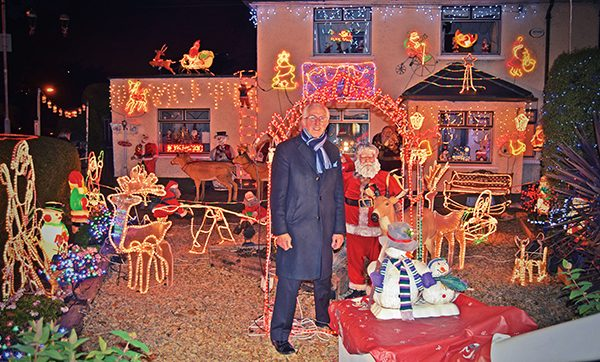 Mr Tilly lights up his house on Bath Avenue.   Photo: Kevin O'Gorman.