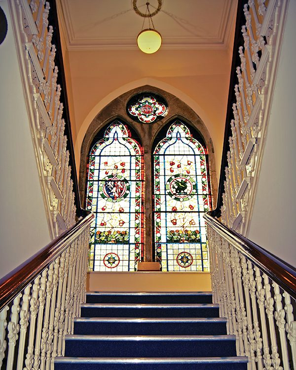Pictured: The elegant staircase of Pembroke Hall.